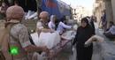 Жители сирийского Алеппо получили от российских военных рис, муку и тушенку